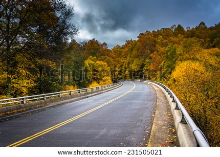 Autumn color and bridge on the Blue Ridge Parkway in North Carolina. - stock photo