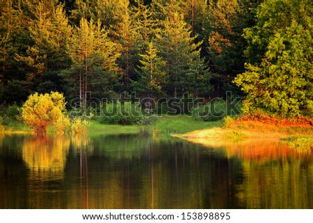 autumn colorful lake in bulgarian forest  - stock photo