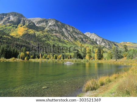 Autumn colors above a lake in the Colorado Rockies, USA. - stock photo