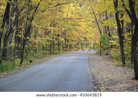 Autumn Colors Along a Rural Road in Devils Lake State Park near Baraboo, Wisconsin - stock photo