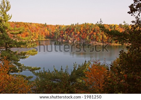 Autumn colors and view of Pink Lake - stock photo