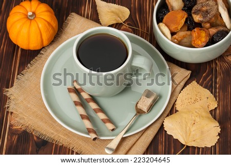 Autumn Concept. Cup Of Tea Or Coffee. Dried Fruits. Chocolate Sweets. Wooden Background.
