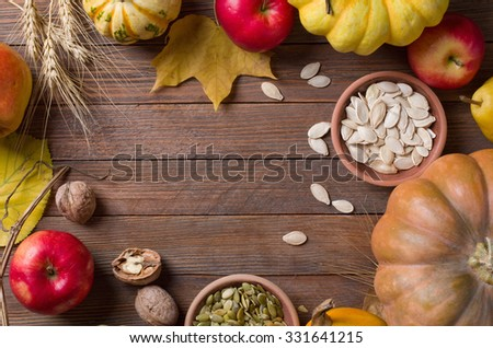 Autumn concept with seasonal fruits - stock photo