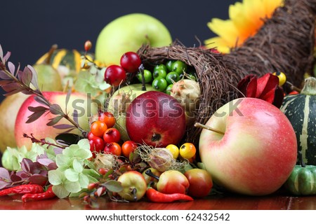 Autumn cornucopia with various fruits and vegetables - symbol of food and abundance - stock photo