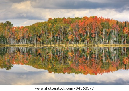 Autumn, Council Lake with reflections of trees and clouds in calm water, Michigan's Upper Peninsula, USA