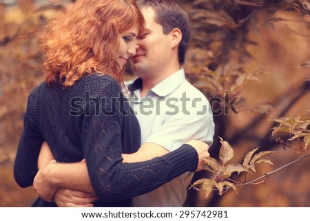 Autumn couple love walk - stock photo