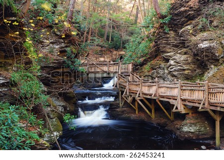 Autumn creek with hiking trails and foliage in forest. From Bushkill Falls, Pennsylvania. - stock photo