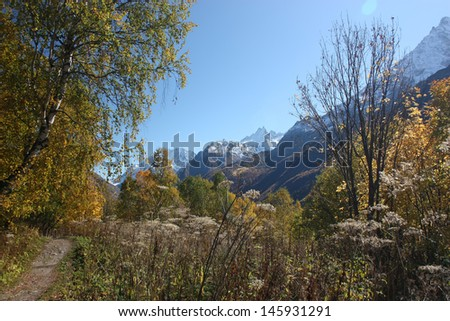 Autumn day with clouds in the mountains