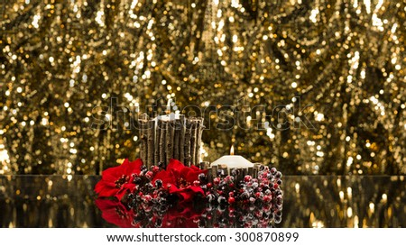 Autumn decorated candles in front of a gold background - stock photo