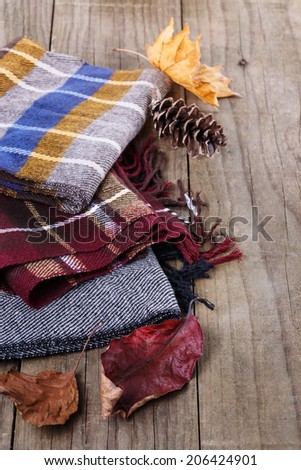 Autumn (fall) still life with scarves and colorful leaves