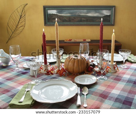 Autumn Fall theme Thanksgiving dinner table place setting