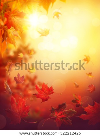 Autumn falling leaves on colorful background - stock photo