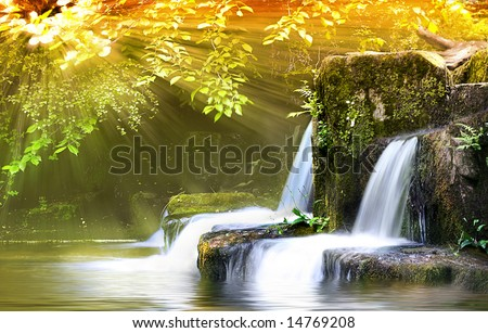 Autumn Falls, light shafts burst through forest onto wide angle long exposure capture of Waterfalls - stock photo