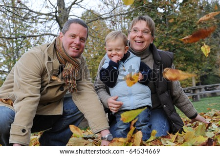 Autumn Family Picture with Little Boy - stock photo