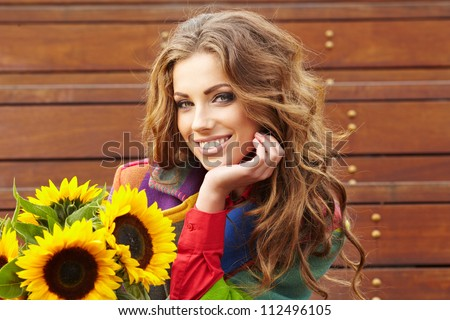 Autumn fashion woman with flowers - stock photo