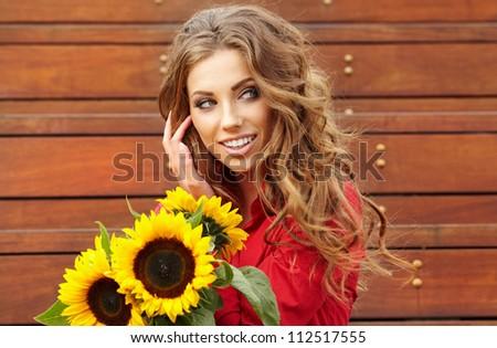 Autumn fashion woman with flowers - stock photo