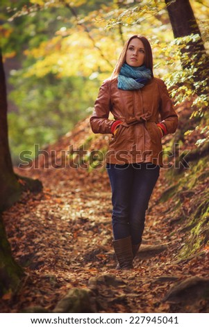 Autumn fashion / Young woman in the forest with warm clothes