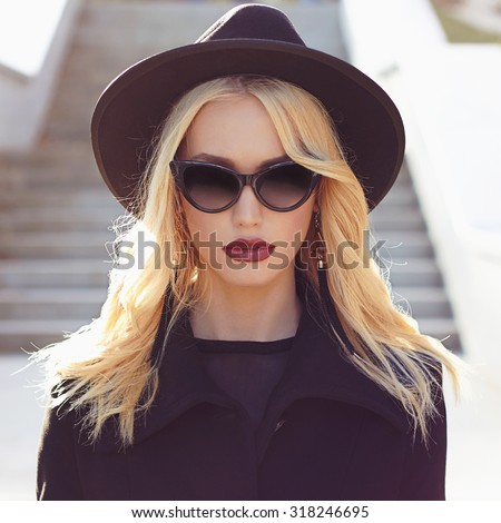 autumn fashionable Beautiful Blond Woman.Beauty blonde Girl in sunglasses.lady in hat - stock photo