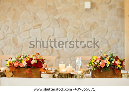 autumn flower composition with roses, chrysanthemum and maple leaves - stock photo