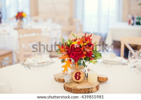 autumn flower composition with roses, chrysanthemum and maple leaves