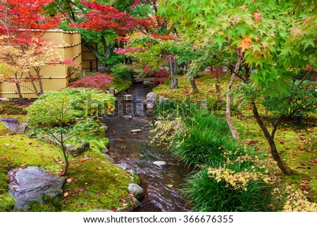 Autumn foliage garden and small lake at Eikando temple in Kyoto, Japan - stock photo