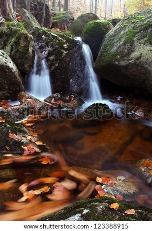 Autumn forest rocks creek in the woods - stock photo