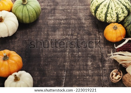 Autumn frame from pumpkins and corn on old wooden table. Thanksgiving day concept  - stock photo