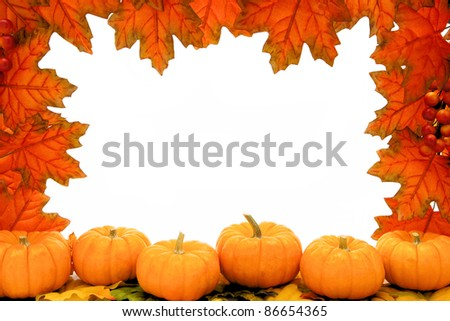 Autumn frame of red maple leaves and pumpkins