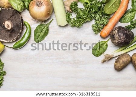 autumn fresh fruits vegetables and herbs on a white rustic background top view - stock photo