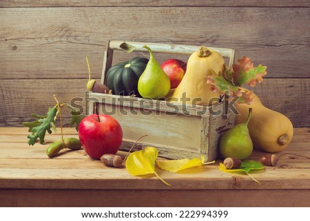 Autumn fruits and pumpkin on wooden table. Thanksgiving dinner - stock photo
