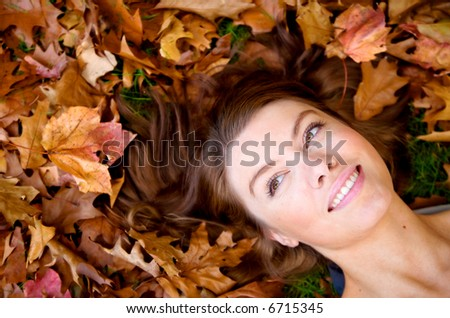 autumn girl portrait on the floor smiling - stock photo