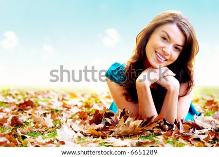 autumn girl portrait outdoors with a blue sky in the background - stock photo