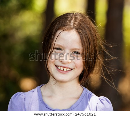 Autumn girl portrait smiling outdoors at the park - stock photo