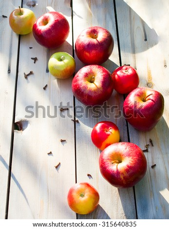Autumn harvest of apples. Red apples on a wooden background. Healthy eating - stock photo