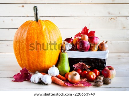 Autumn harvest of fruits and vegetables on a wooden background - stock photo