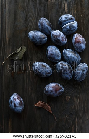 autumn harvest - plums on the table