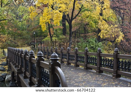 Autumn in Central Park with view over the Bank rock bridge - stock photo