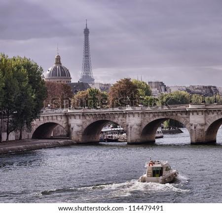 autumn in Paris, Seine river and Eiffel tower - stock photo