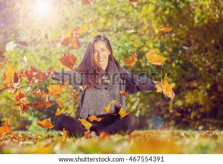 Autumn in park,Young smiling woman relaxing in nature, Vintage efect
