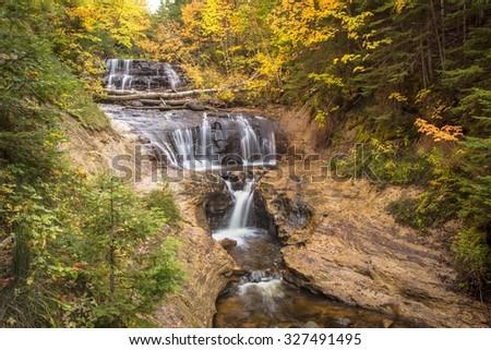 Autumn in Sable Falls. Autumn at beautiful Sable Falls in Pictured Rocks National Lakeshore. Grand Marais, Michigan. - stock photo
