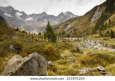 Autumn in the alpine upland valley - stock photo