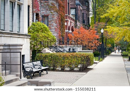 Autumn in the City Autumn color on the city streets of an urban neighborhood near downtown Chicago, Illinois. - stock photo