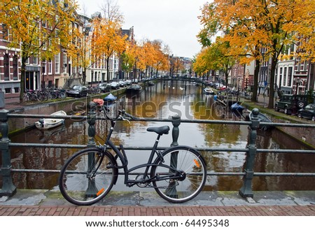 Autumn in the Netherlands with canal and bicycle - stock photo