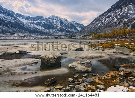 Autumn in the upper reaches of river Arhat - stock photo