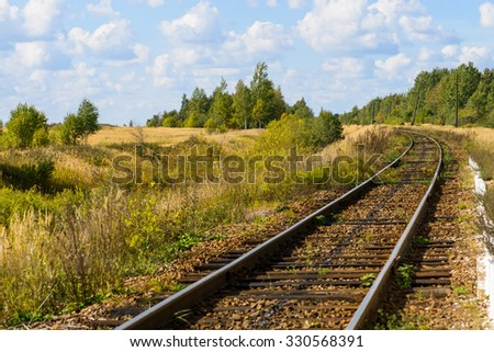 Autumn Industrial landscape, railway receding into the distance