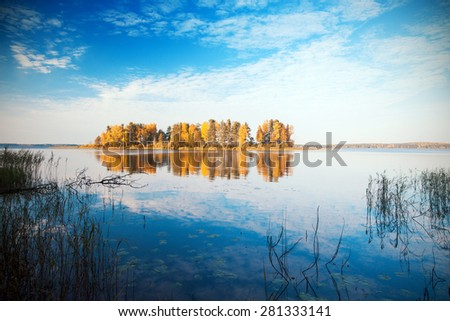 Autumn island and lake - stock photo