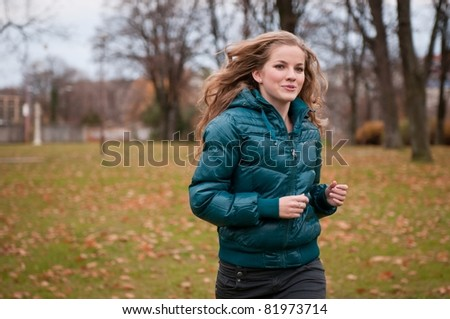 Autumn jogging - young woman