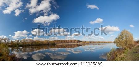 Autumn lake a panorama the sky - stock photo