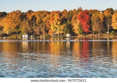 Autumn lake reflection - stock photo