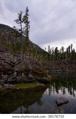 Autumn lake with trees in Altai, Russia